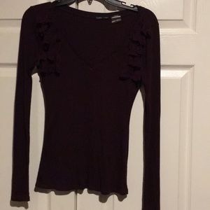 Deep purple v neck top with ruffled accents